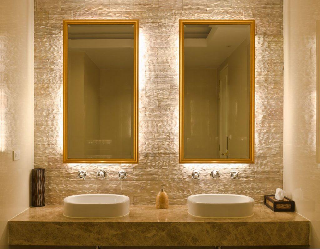Custom lighting behind bathroom mom and pop mirrors